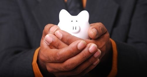 Holding Piggy Bank   CSG Partners